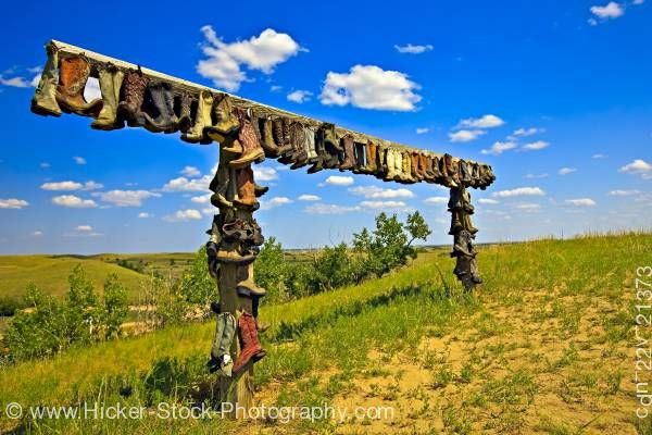 Stock photo of Cowboy boots posts Great Sand Hills near Sceptre Saskatchewan Canada