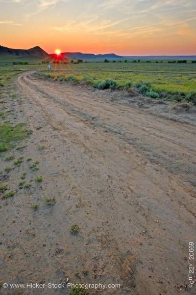 Stock photo of Farmland dirt road sunset Big Muddy Badlands Southern Saskatchewan Canada