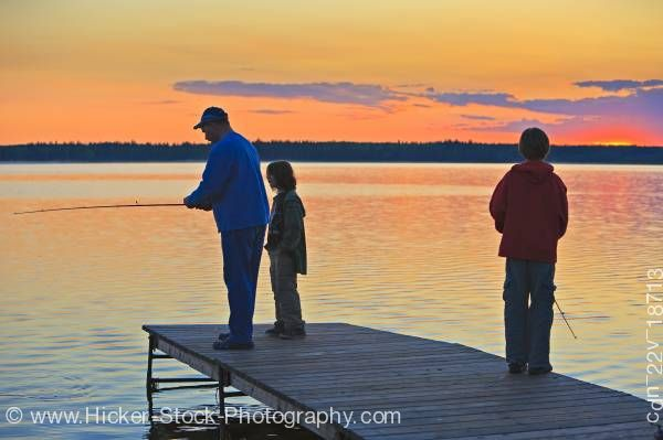 Stock photo of Father sons Lake Audy Riding Mountain National Park Manitoba Canada