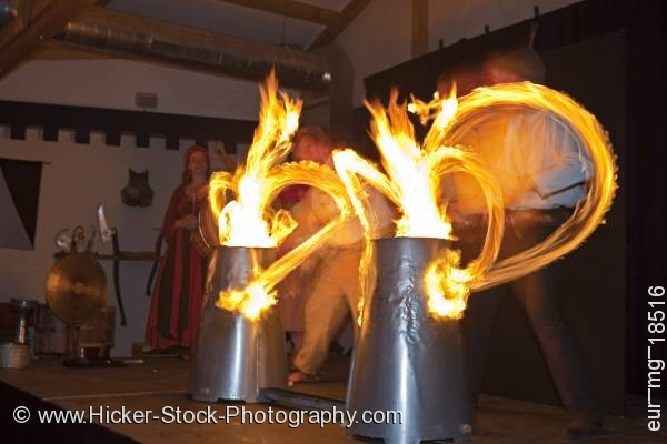 Stock photo of Entertainers drumsticks lit by fire medieval feast