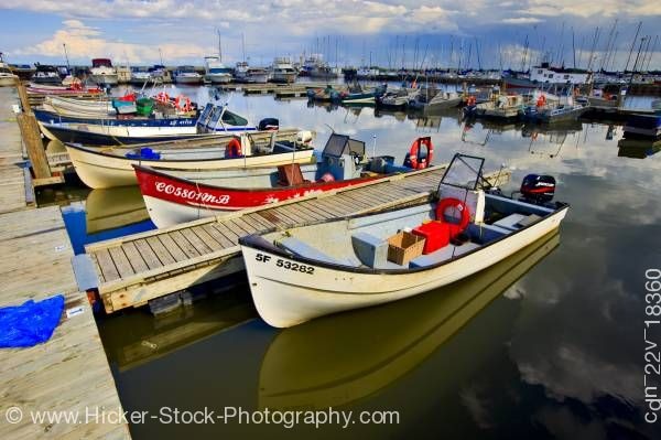 Stock photo of Fishing boats Main Dock Boat Harbour shores of Lake Winnipeg in the town of Gimli Manitoba Canada