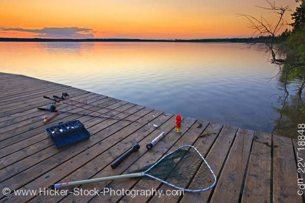 Stock photo of Sunset fishing equipment wharf Lake Audy Riding Mountain National Park Manitoba Canada