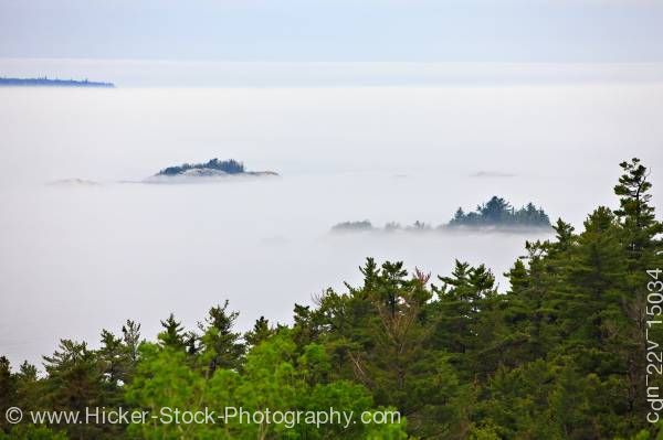 Stock photo of Lake Superior shrouded by fog near Lizard Island in Lake Superior Provincial Park in Ontario Canada
