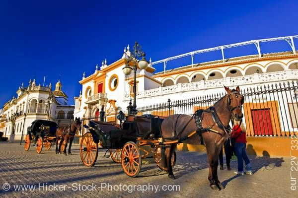 Stock photo of Horse drawn carriage Plaza de Toros de la Maestranza (Bullring) City of Sevilla