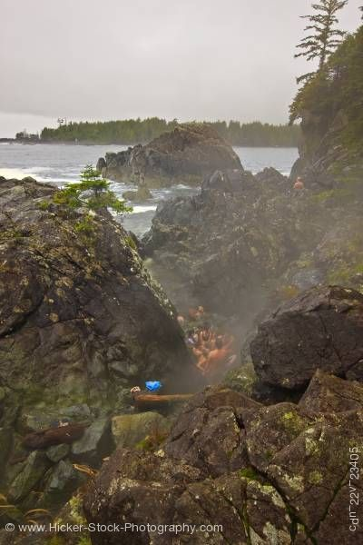 Stock photo of People bathing Hot Springs Cove Openit Peninsula Maquinna Marine Provincial Park