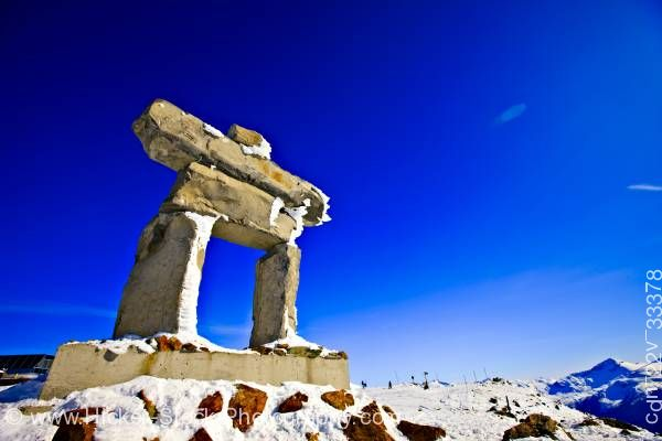 Stock photo of Large Inukshuk Ilanaaq Whistler Mountain Whistler British Columbia Canada Blue Sky