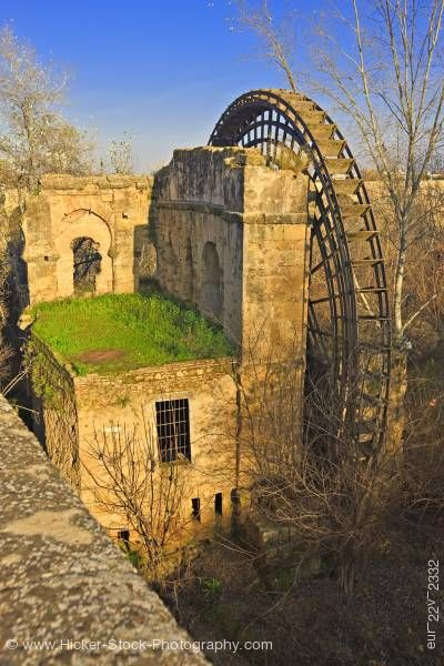 Stock photo of Molino de la Albolafia large Islamic water wheel on Rio Guadalquivir in city of Cordoba