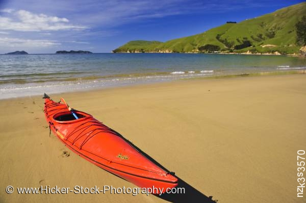 Stock photo of Red Kayak Titirangi Bay Beach Marlborough South Island New Zealand