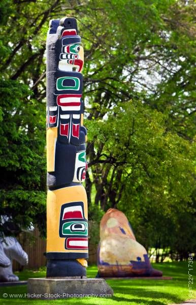 Stock photo of Kwakiutl Totem Pole on the Legislative Building Grounds in the City of Winnipeg in Manitoba Canada