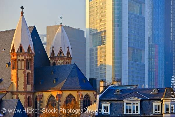 Stock photo of Leonardikirche oldest church modern buildings downtown Frankfurt Hessen Germany Europe