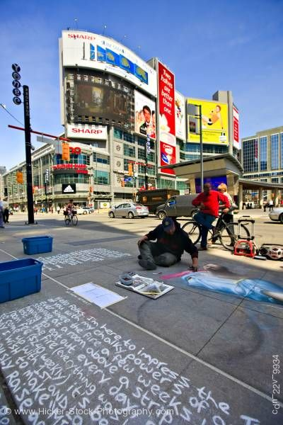 Stock photo of Chalk Artist on Pavement Buildings and Blue Sky in Downtown Toronto Ontario Canada