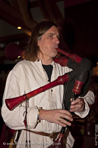 Stock photo of Man Medieval musical instrument castle Auerbach Germany