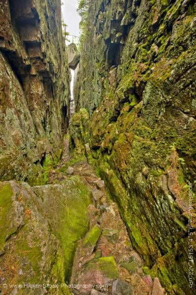 Stock photo of Large Rock Wedged Above Deep Chasm Agawa Rock Pictographs Trail Lake Superior Ontario Canada