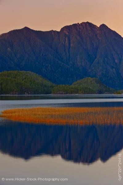 Stock photo of Mountain reflections Clayoquot Arm of Kennedy Lake Clayoquot Sound Vancouver Island British Columbia