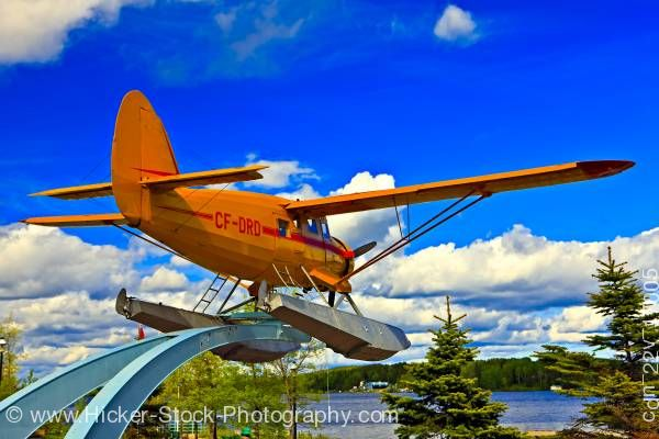 Stock photo of Norseman Aircraft on Pedestal in Norseman Heritage Centre Park Blue Sky Red Lake Ontario