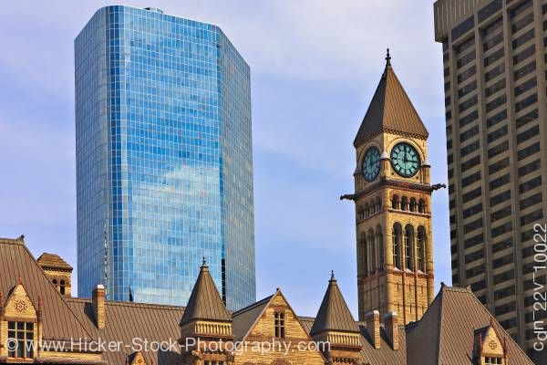 Stock photo of Old City Hall Clock Tower Blue Sky and Modern Buildings Downtown Toronto Ontario Canada