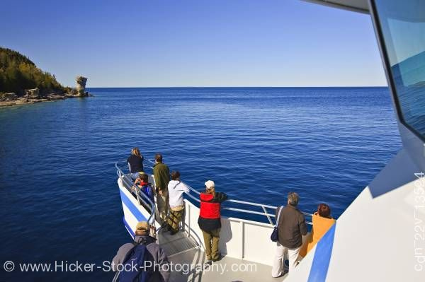 Stock photo of Passengers Great Blue Heron tour boat Tobermory Fathom Five National Marine Park Lake Huron