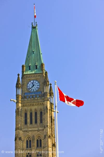 Stock photo of Peace Tower Canadian Flag Blue Sky Parliament Hill City of Ottawa