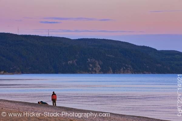 Stock photo of People and sunset over Agawa Bay Lake Superior Provincial Park Ontario