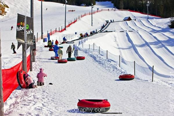 Stock photo of People at Coca Cola Tube Park Blackcomb Mountain Whistler British Columbia Canada