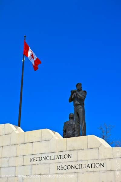 Stock photo of Reconciliation Peacekeeping Monument and Canadian Flag Ottawa