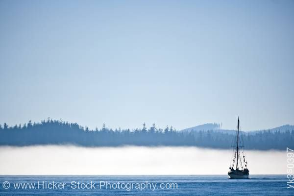 Stock photo of Sailboat in fog near Port Hardy Vancouver Island British Columbia Canada