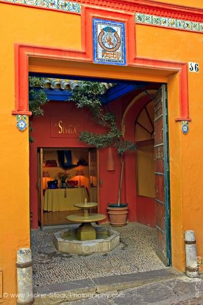 Stock photo of Shop entrance Santa Cruz District City of Sevilla Andalusia Spain