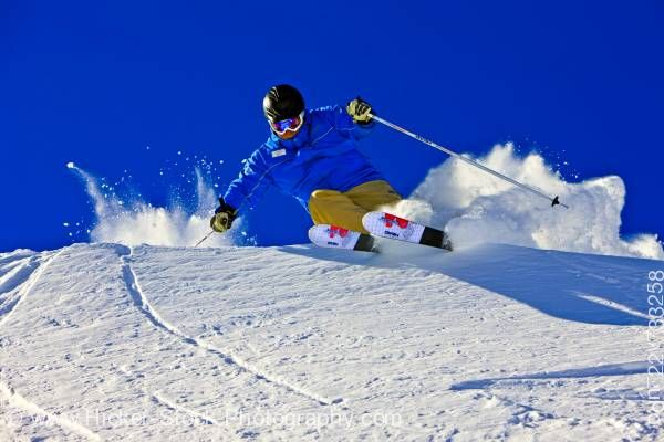 Stock photo of Action Downhill Skier Whistler Mountain British Columbia Canada Blue Sky