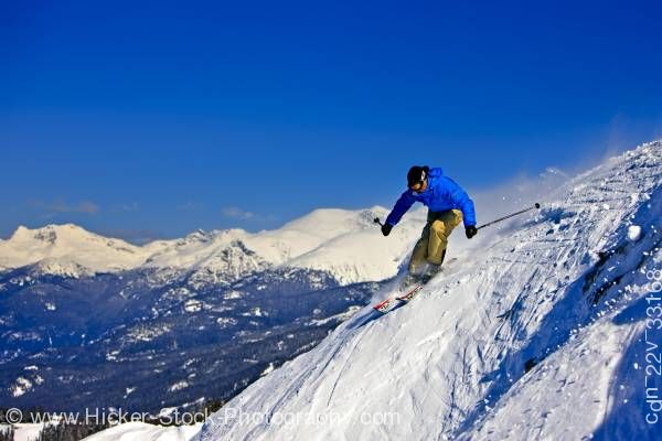 Stock photo of Skier Steep Slope Whistler Mountain Blue Sky British Columbia Canada