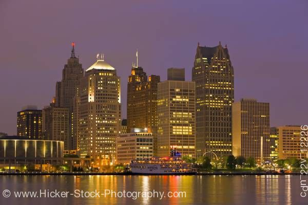 Stock photo of Skyline Detroit Michigan USA at dusk seen from the waterfront in the city of Windsor Ontario