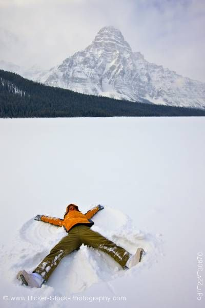 Stock photo of Woman Making Snow Angel on Waterfowl Lake Mount Chephren Icefields Parkway Banff National Park