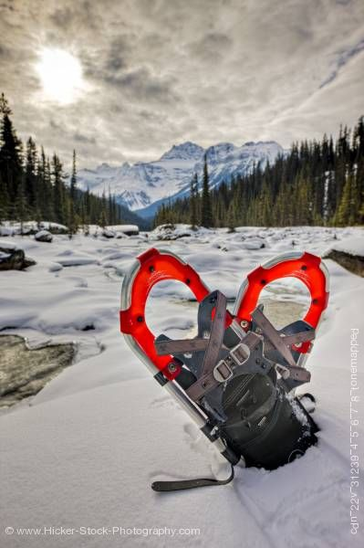 Stock photo of Snowshoes on Mistaya River Bank Mount Sarbach Mistaya Canyon Banff National Park Alberta Canada