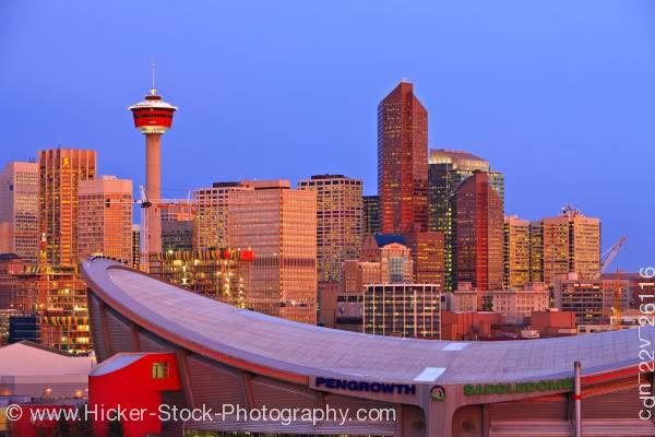 Stock photo of Saddledome High Rise Buildings Calgary Tower Sunrise City of Calgary Alberta Canada