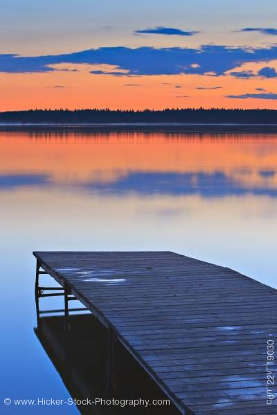 Stock photo of Golden sunset wooden wharf Lake Audy Riding Mountain National Park Manitoba Canada