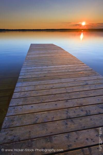 Stock photo of Sunset wharf Lake Audy Riding Mountain National Park Manitoba Canada