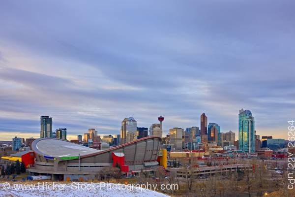 Stock photo of The Saddledome with high-rise buildings the Calgary Tower City of Calgary Alberta Canada