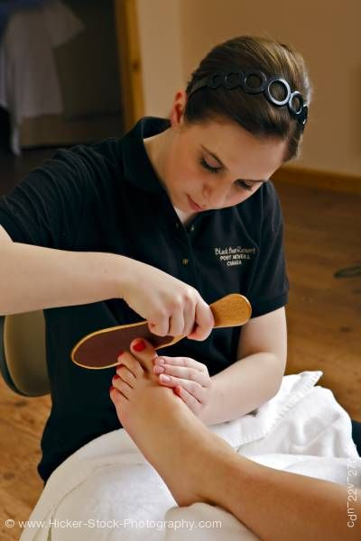 Stock photo of Therapist pedicure Black Bear Resort & Spa Port McNeill North Vancouver Island Vancouver Canada