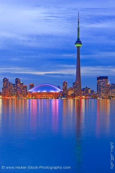 Stock photo of Toronto City Skyline with CN Tower and Rogers Centre at Dusk City of Toronto Ontario Canada