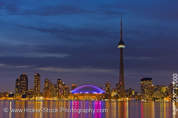 Stock photo of Skyline of Toronto with CN Tower and Rogers Centre at Dusk over Lake Ontario City of Toronto Ontario
