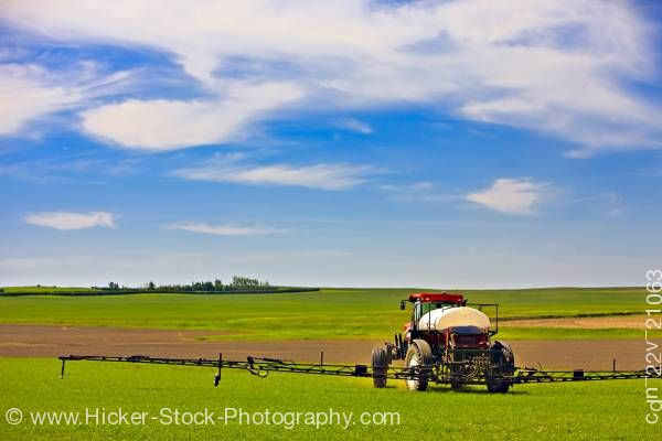 Stock photo of Tractor spraying crops Town of Rockglen Southern Saskatchewan Canada