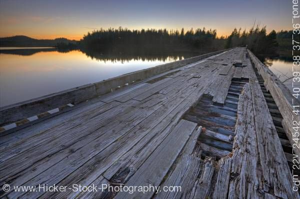 Stock photo of Wooden bridge sunset Clayoquot Arm of Kennedy Lake Vancouver Island British Columbia Canada