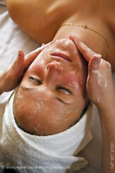 Stock photo of Woman receiving facial massage Black Bear Resort Spa Wellness Port McNeill