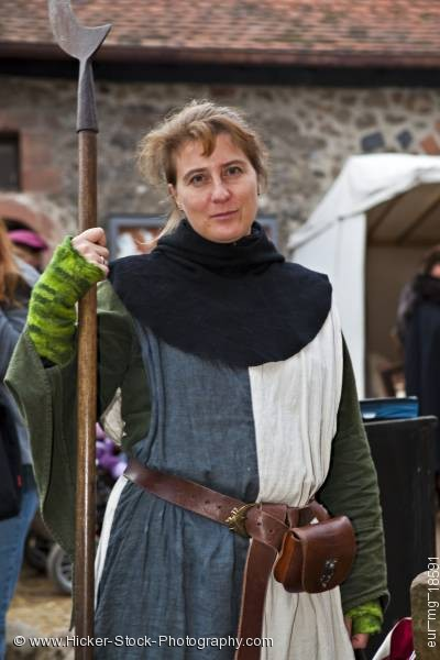 Stock photo of Woman dressed medieval guard clothing medieval markets Burg Ronneburg Germany